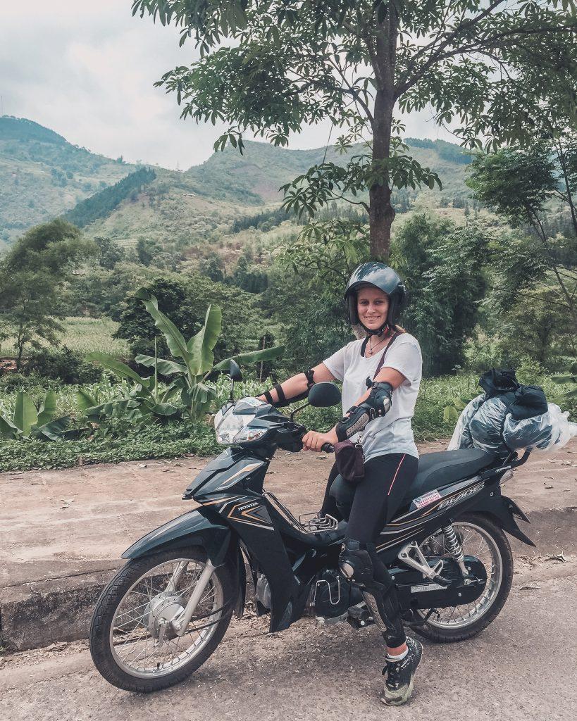 Girl on a motorbike being vegan on the Ha Giang Loop.